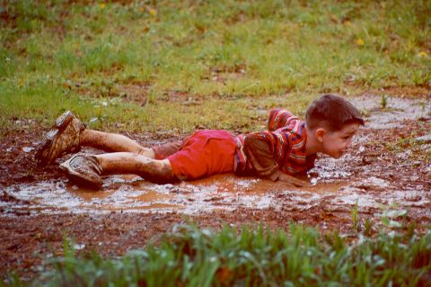[Joshua playing in the mud - Spring 2000]